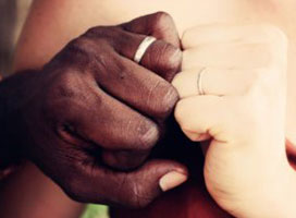 Couple hands with wedding rings