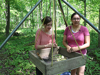 Nadine Finaly and Shauna Kechego-Nichols sort findings in field school