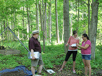 Neal Ferris, Nadine Finlay and Shauna Kechego-Nichols at anthropology field school